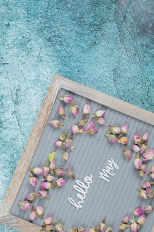 Hello may poster with flower blossoms around