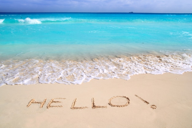 Hello message spell written in tropical beach sand