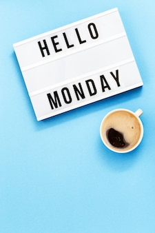 Hello monday text and cup of coffee