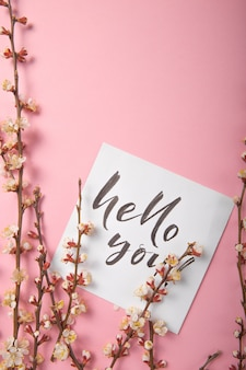 Hello my love handwritten inscription. hand drawn lettering,  calligraphy. card with spring tree brunch background, valentine day