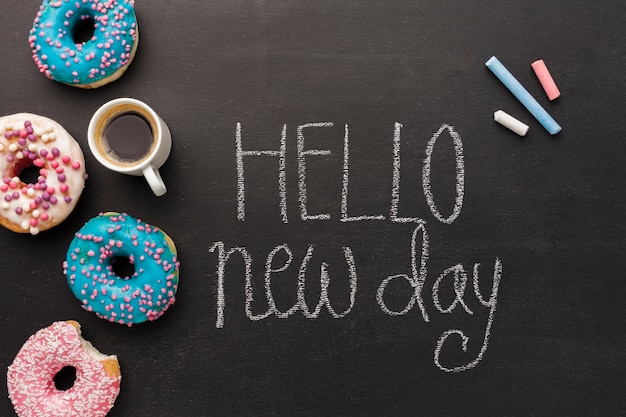 Hello new day with doughnut collection and coffee