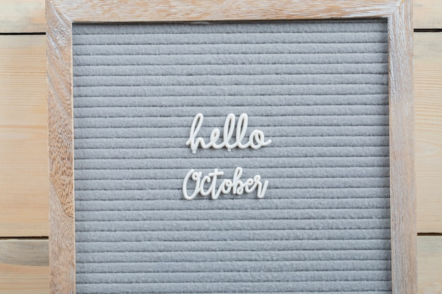 Hello october poster on brown surface