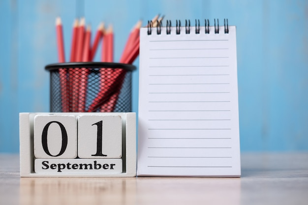 Hello september calendar, welcome back to school  with notebook and pencils. copy space for text