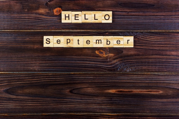 Hello september word. wooden cubes on wooden background