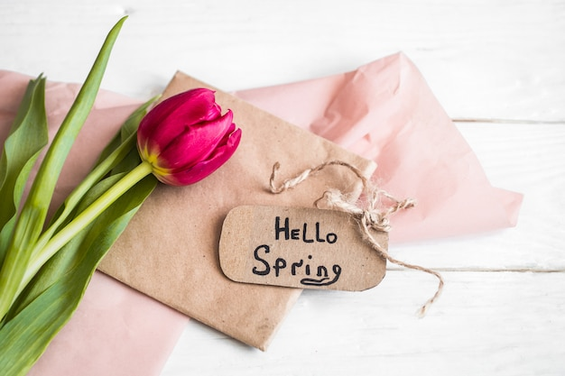 Hello spring paper tag with tulip flower