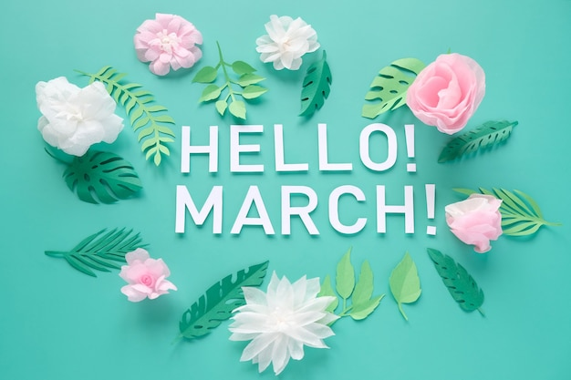 Hello, spring. with white and rose paper flowers on mint background. tenderness concept