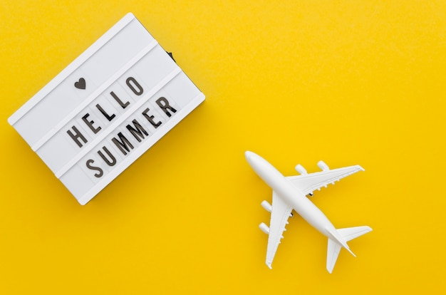 Hello summer message beside airplane toy