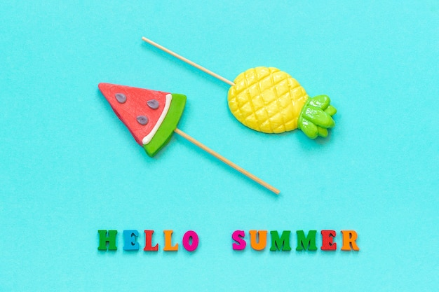 Hello summer pineapple watermelon lollipops. concept vacation or holidays template greeting card, postcard