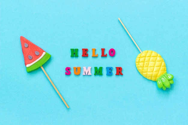 Hello summer, pineapple and watermelon lollipops. concept vacation or holidays