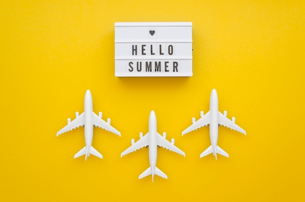 Hello summer tag with airplanes on table