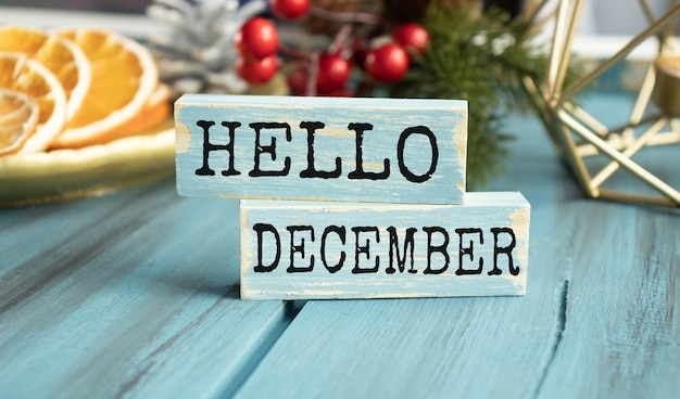 Hello winter word written on wood block. hello winter text on wooden table for your desing, concept.