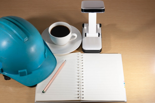 Helmet, coffee, on the desk, anytime, anywhere.
