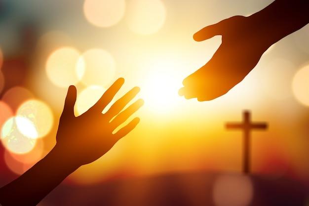 도움의 날 개념: 실루엣 두 손