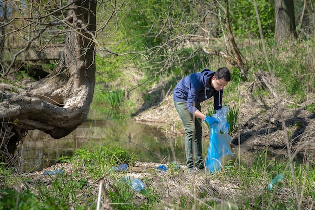 Help the ecology of the planet by collecting garbage in nature
