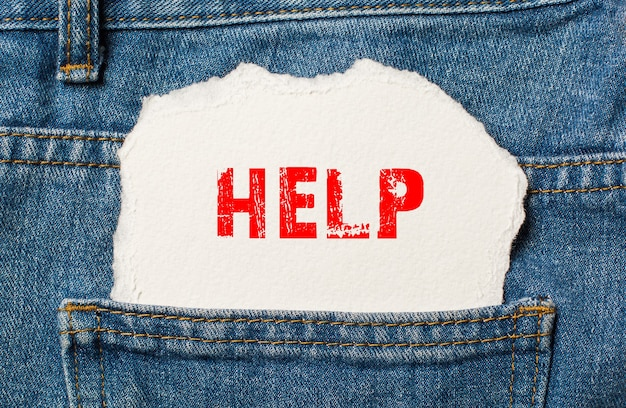 Help on white paper in the pocket of blue denim jeans