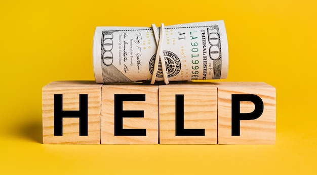 Help with money on a yellow background. the concept of business, finance, credit, income, savings, investments, exchange, tax