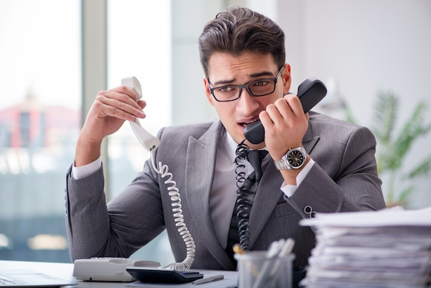Helpdesk operator talking on phone in office