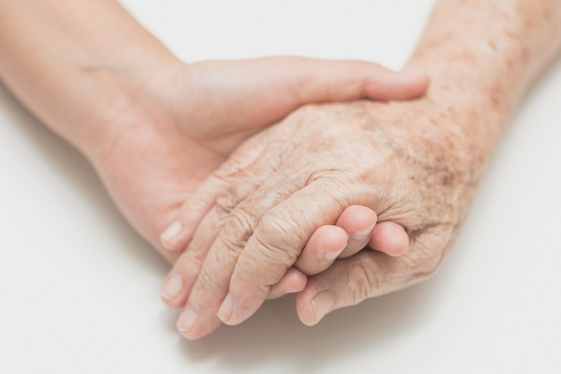 The helping hands for elderly home care,help concept.