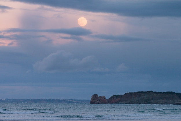 Hendaia's beach with full moon before eclypse at the basque country