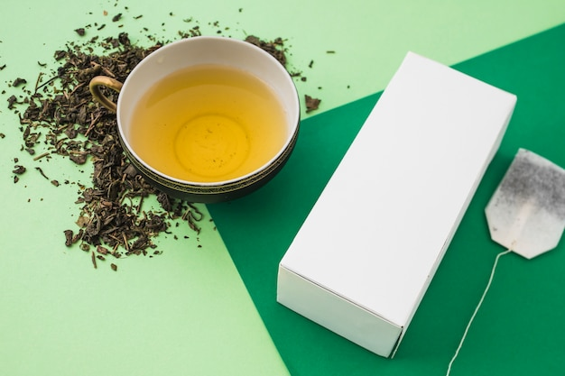 Herb box with tea cup on light and dark background