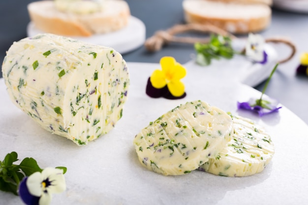 Herb butter with edible flowers