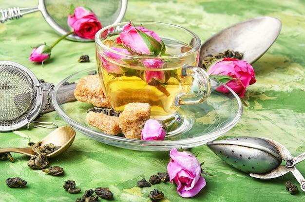 Herb tea with tea rose petals