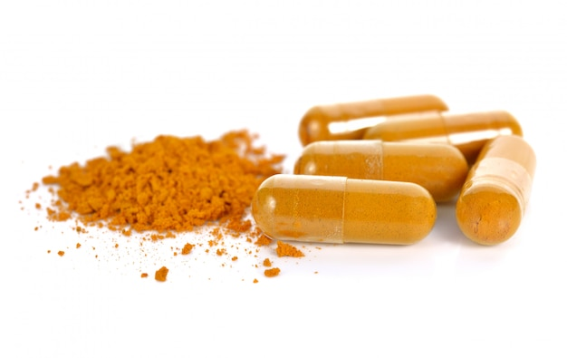 Herb turmeric capsules isolated on white