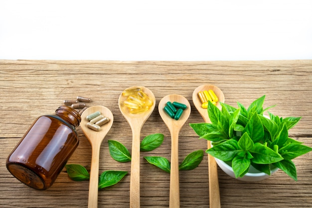 Herbal capsule from herb nature on wooden table