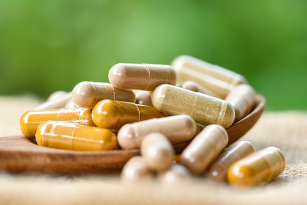 Herbal capsules on a pile