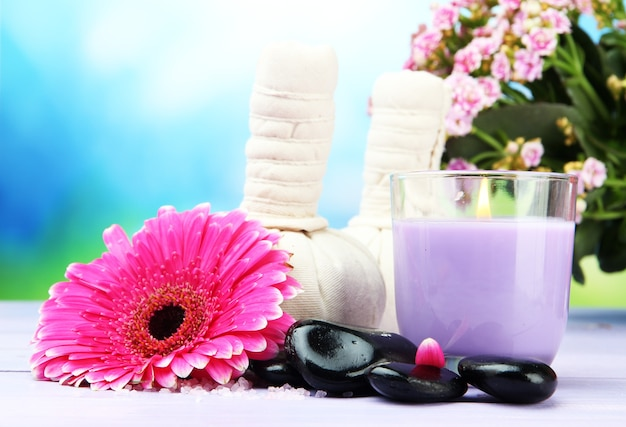 Herbal compress balls for spa treatment, spa stones, gerbera and candle