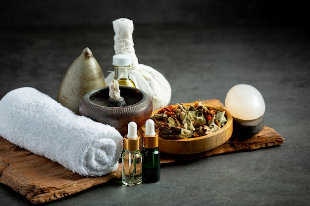 Herbal compress and herbal spa treatment equipments put on dark floor