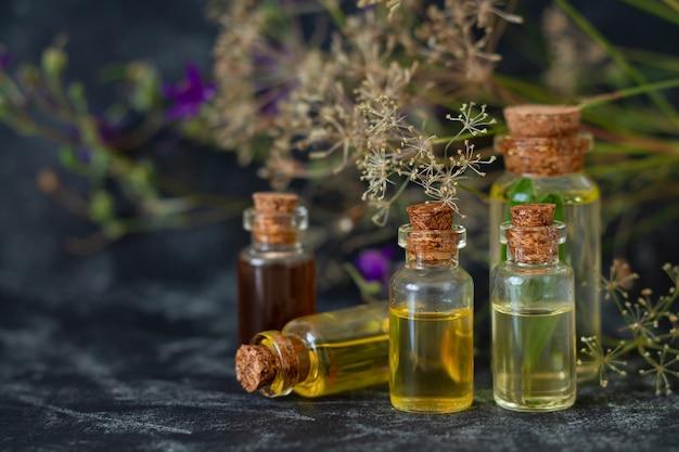 Herbal essential oils in glass bottles.