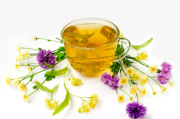 Herbal medicine. cup of lime blossom tea with chamomile flowers and cornflower. linden tea