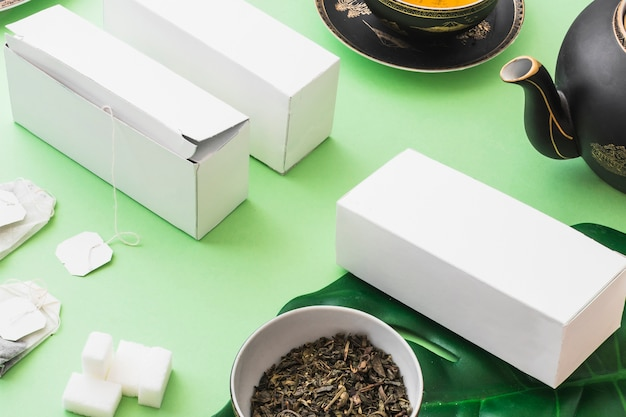 Herbal tea boxes with tea and sugar cubes