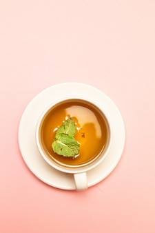 Herbal tea from mint and other herbs on a white background
