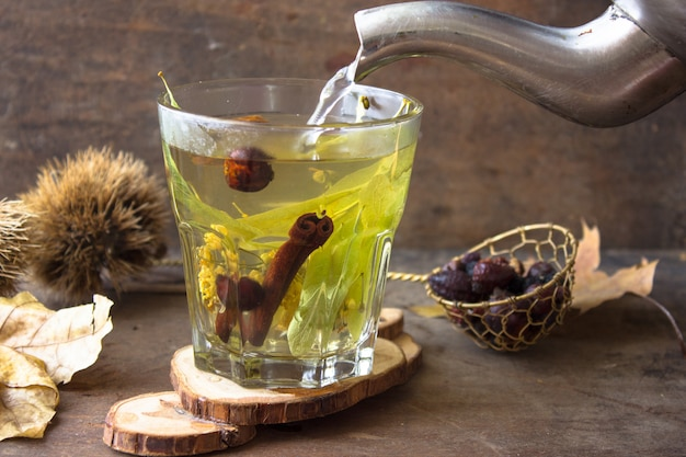 Herbal tea in a glass cup.