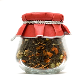 Herbal tea in glass jar isolated over white