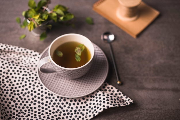 Herbal tea and polka dotted cloth on table