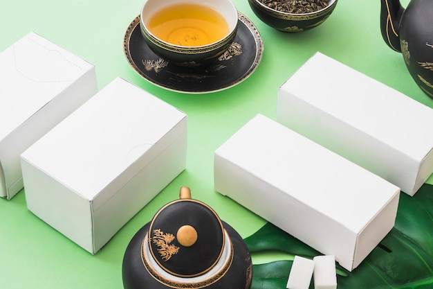 Herbal tea with four white boxes on pale green backdrop