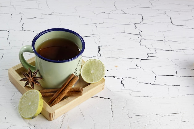 Herbal tea with ingredients lime cinnamon and star anise