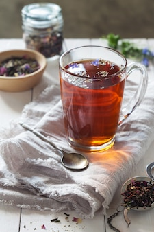 Herbal tea with a spoon on linen