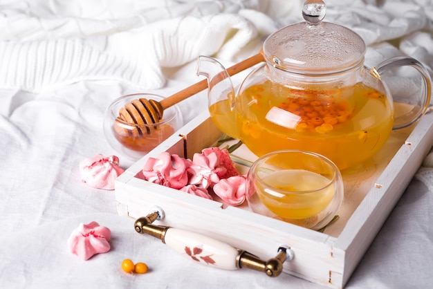 Herbal tea on a wooden tray