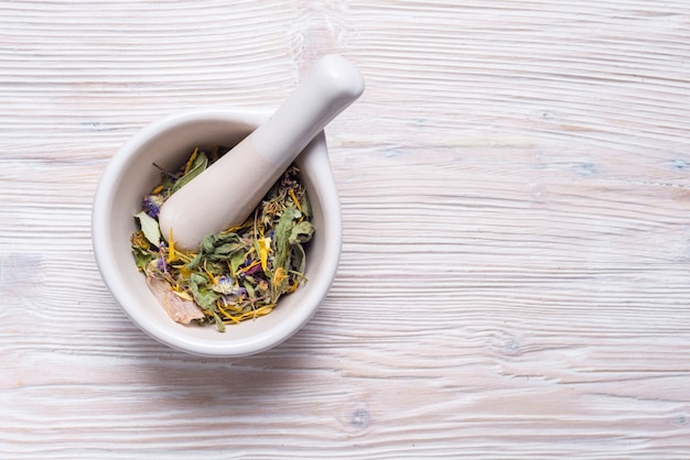 Herbal and white porcelain mortar