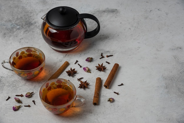Herbal winter tea in the cups with spices.