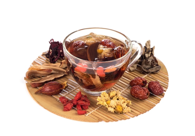 Herbals tea contains goji berry, licorice, chrysanthemum, jujube, roselle, lingzhi and jelly ear mushrooms. Premium Photo