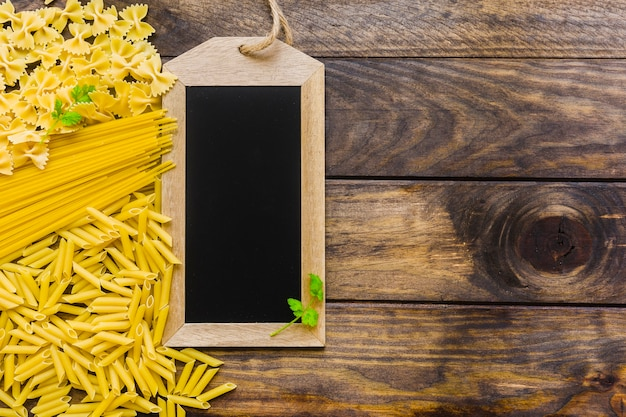 Herbs on chalkboard and pasta