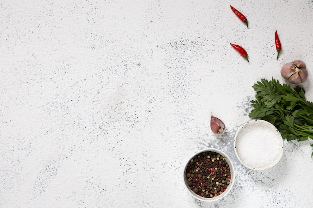 Herbs for cooking on white concrete
