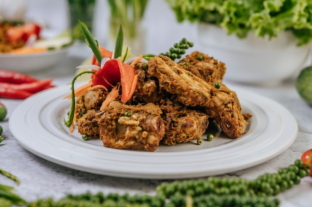 Herbs fried pork with chili, tomato, cucumber, carrot, and fresh pepper