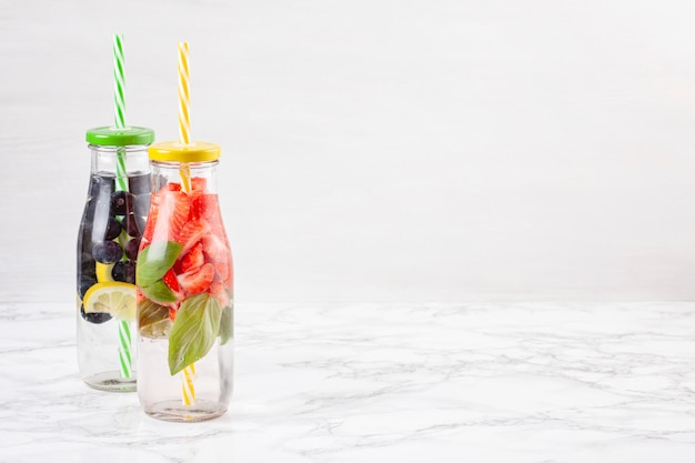 Herbs and fruits flavored infused water. summer refreshing drink. health care, fitness, healthy nutrition diet concept.