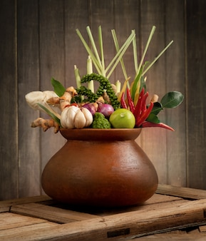 Herbs and spices ingredients spicy soup fresh vegetables for tom yum thai isolated on white surface.